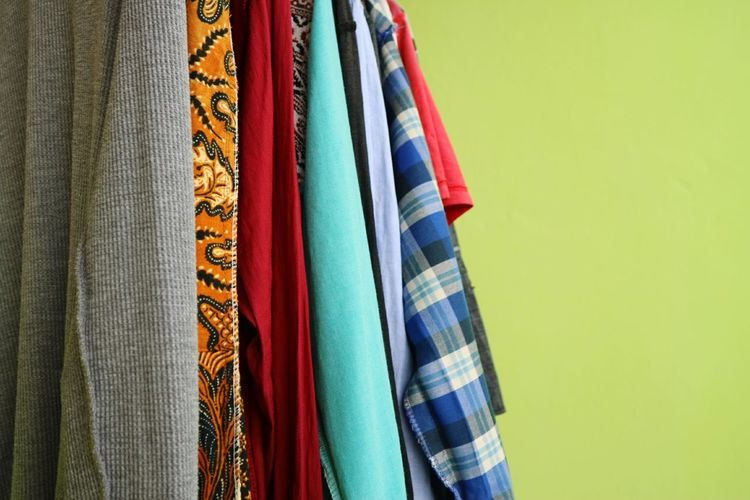 Close-up of multi colored clothes hanging on display at store