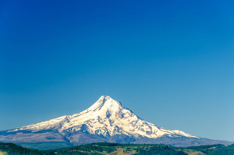 Scenic View Of Mount Hood Against Clear Blue Sky During Winter
