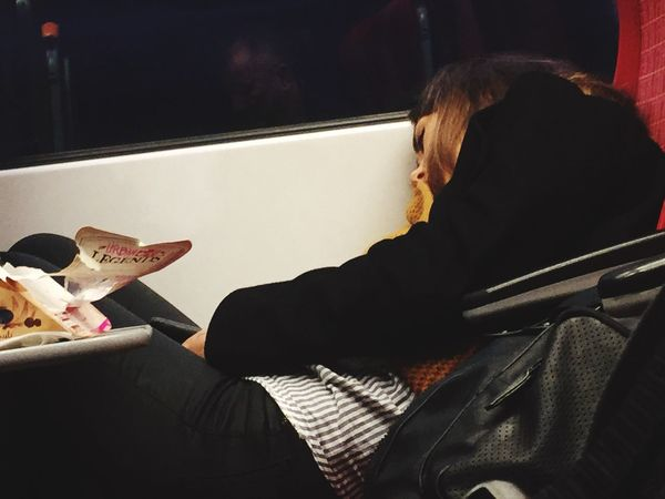 'Long old journey' tired looking woman on train leaning against window Real People Sitting One Person Indoors  Young Adult Tired Journey Train Bored
