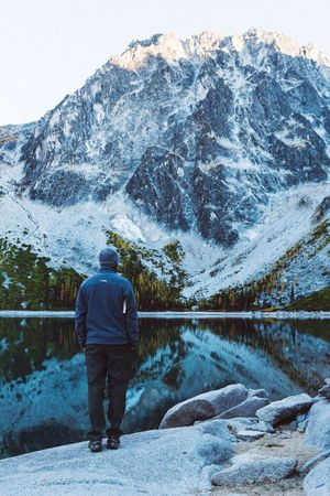 """People And Places """"Cold morning"""". Colchuck Lake, The Enchantments, Washington State. Mountain First Eyeem Photo Full Length Cold Temperature Men Leisure Activity Tranquil Scene Scenics Beauty In Nature Solitude Nature Remote Pacific Northwest  Adventure Outdoors Beauty In Nature Nature Photography Hiking Lake Mountains Majestic Adventure Club"""