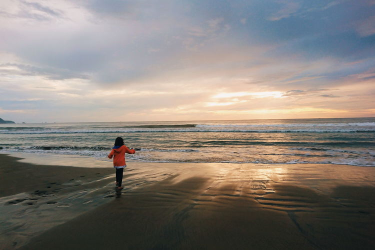 leupung beach Beach Sea Full Length Horizon Over Water One Person People Water Standing Sunset Sand One Man Only Vacations Outdoors Adult Sky Summer Cloud - Sky Child Boys Day An Eye For Travel Moments Of Happiness