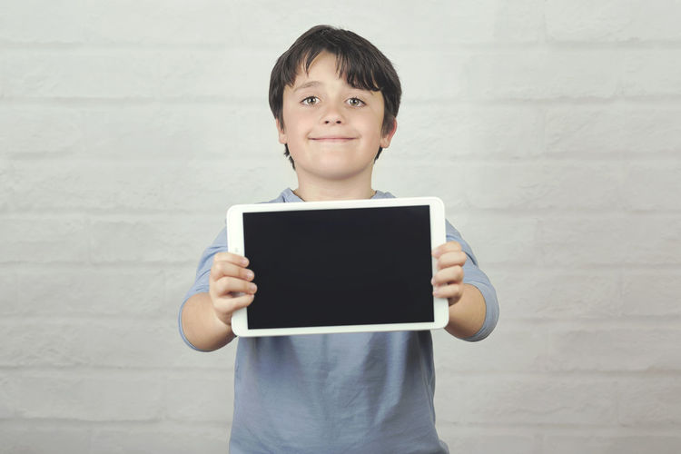 Child Screen Tablet Digital Computer Communication Student Happy Internet Happiness Concept Technology Cyber Space Fun Education Childhood Lifestyle Smile Tactile Connection Learn Learning Imagination Play School Leisure Entertainment Holding Kid Portrait Touchscreen Touch Looking At Camera Standing Smiling Innocence