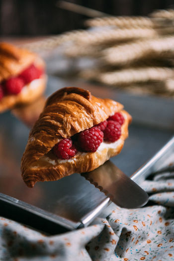Raspberry Cream Cheese Croissant Baked Baked Pastry Item Berry Fruit Breakfast Close-up Cream Cheese Croissant Food Food And Drink French Food Freshness Fruit Healthy Eating Indulgence No People Plate Raspberry Ready-to-eat Selective Focus Snack Still Life Sweet Food Temptation