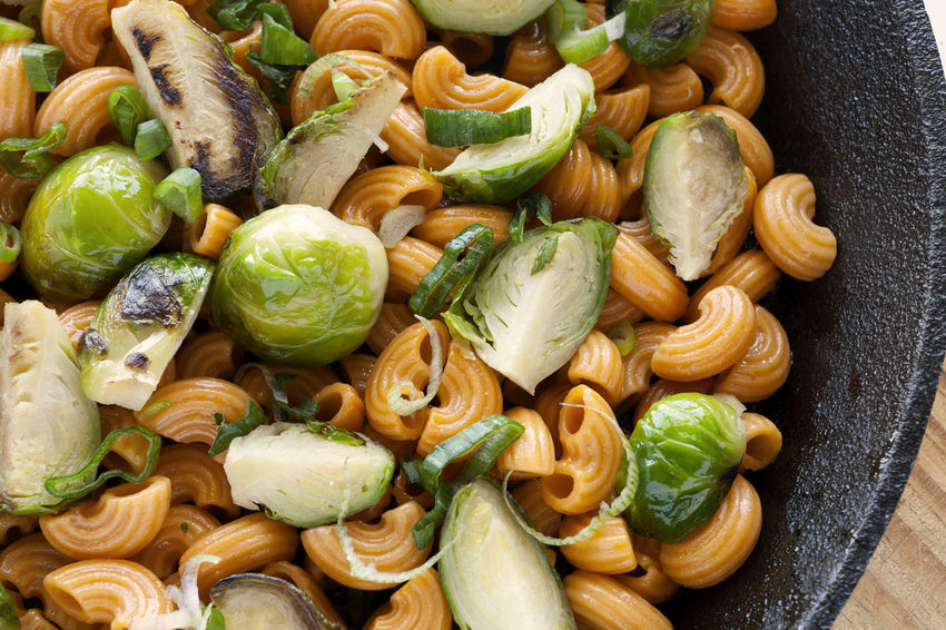 Macaroni and Brussels Sprouts Skillet. Closeup Natural Light Vegetarian Food Brussels Sprout Carrot Pasta Close-up Color Pasta Cruciferous Food Food And Drink Healthy Eating No People Pasta Ready-to-eat Roasted Sauteed Scallions Skillet Skillet Recipe Studio Photography Vegan Vegan Food Vegetrarian Wooden Background