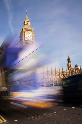 Blurred motion of bus against big ben in city