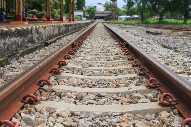 railway track on gravel for train transportation: Select focus with shallow depth of field : Track Day No People Outdoors Rail Transportation Railroad Tie Railroad Track Railway Railway Bridge Railway Station Railway Track View Transportation