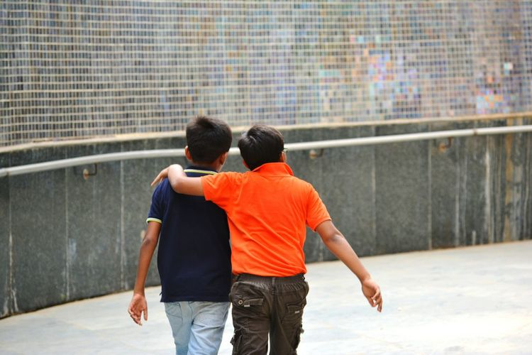 Two People Togetherness Love Friendship Rear View Male Friendship Walking Bonding Enjoyment Day Arm In Arm Nikon EyeEm Best Shots The Great Outdoors - 2017 EyeEm Awards Kids Live For The Story