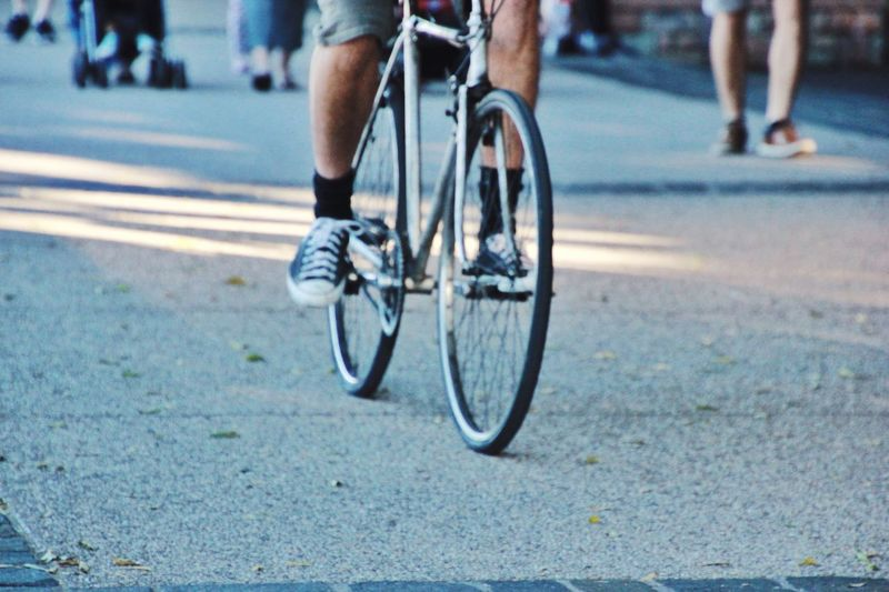 Low Section Of Man Cycling On Road