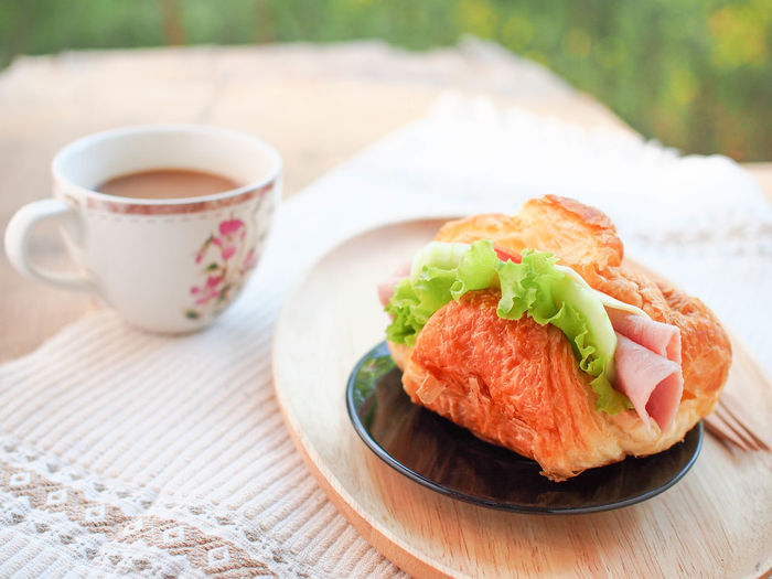 Fresh croissant in fresh morning Breakfast Close-up Cup Drink Focus On Foreground Food Food And Drink Freshness Healthy Eating Meal Mug No People Ready-to-eat Snack Table Tea Tea Cup