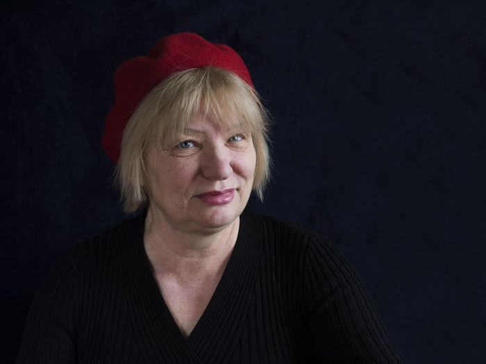 Portrait of mature woman on black background