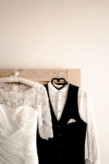 Coathanger Clothing Hanging Indoors  No People Fashion Copy Space Wall - Building Feature White Color Still Life Dress Casual Clothing White Background Studio Shot Textile Button Down Shirt T-shirt Absence Group Of Objects Clean Womenswear Garment Bride Groom Wedding Wedding Dress Wedding Photography Wedding Day