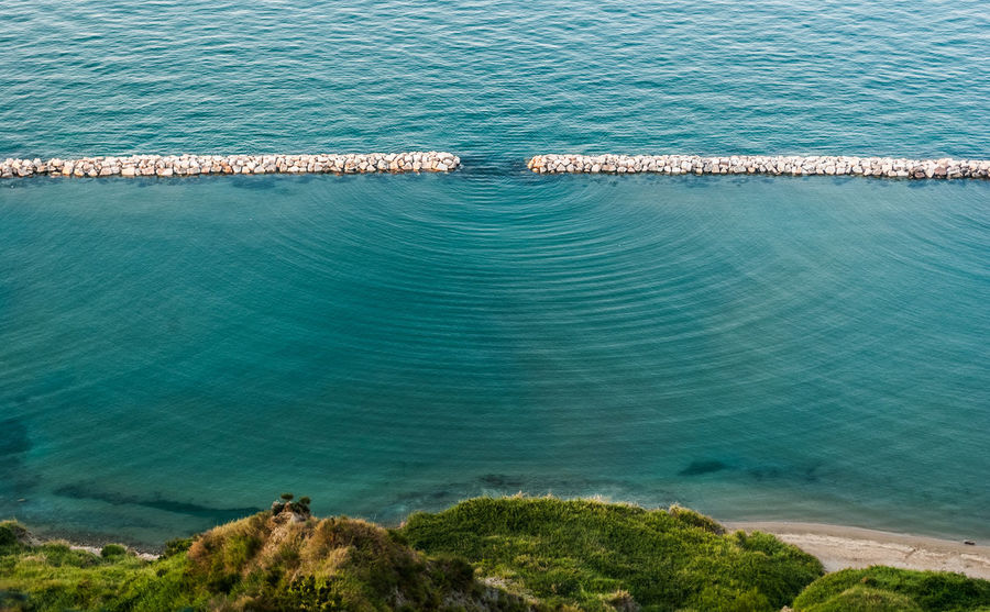 Diffraction waves in the sea seen along the coastline near Pesaro Aerial Aerial View Aperture Beach Diffraction High Angle View Mediterranean  Nature Nature No People Outdoors Pesaro Physics San Bartolo Scenics Science Sea Water Wave Wavelength Waves