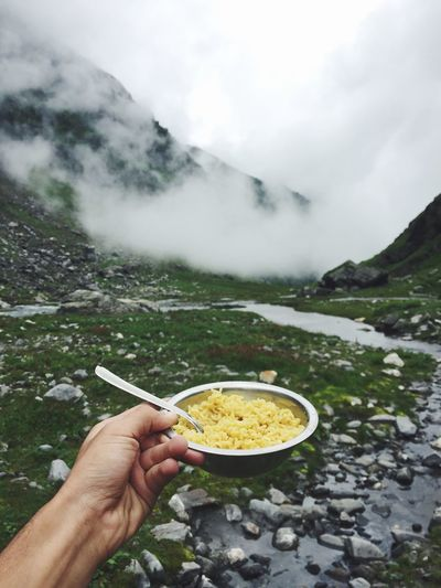 Maggi! Food Person Holding Food And Drink Mountain Personal Perspective Leisure Activity Landscape Altitute Cloud - Sky Non-urban Scene Tourism Part Of Lifestyles Men Cropped Geology Travel Destinations Freshness Vacations Scenics