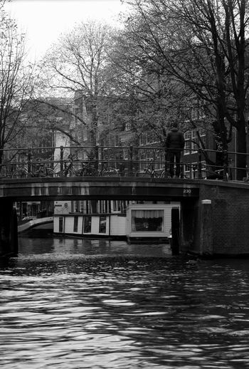 Bridge over canal amidst buildings in city