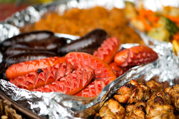 Close-Up Of Various Seafood Served In Container