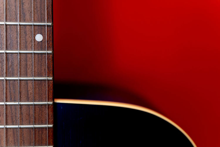 Wood - Material Arts Culture And Entertainment Copy Space Close-up Guitar Music Fretboard Red Blackandwhite Necklace