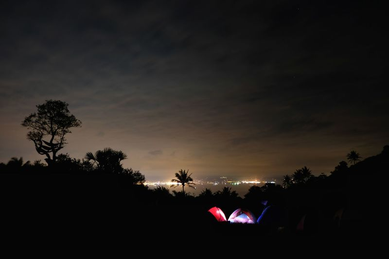 Sunrise? No, this is at 5am, the clouds covered the stars again and the light pollution is more visible. So I accepted the fact that that's it for today, and try to get a nice shot of the galatic core next time. 3 of 3 Glowing Tent EyeEmNewHere Philippines Long Exposure Clouds Campsite EyeEm Nature Lover Batangas Fujifilm Fujifilm X-t20 Hiking Light Pollution Mountain Tent Cityscape Citylights Skyline Tree Silhouette Outdoors Night Sky Nature Go Higher The Great Outdoors - 2018 EyeEm Awards