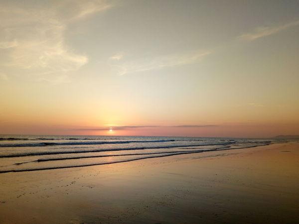 Waves like ripples on the sand under the sunset Aberystwyth Borth Wales Evening Water Low Tide Sea Sunset Beach Sand Summer Sun Sunlight Dramatic Sky Romantic Sky Seascape Coast Coastal Feature Atmospheric Mood