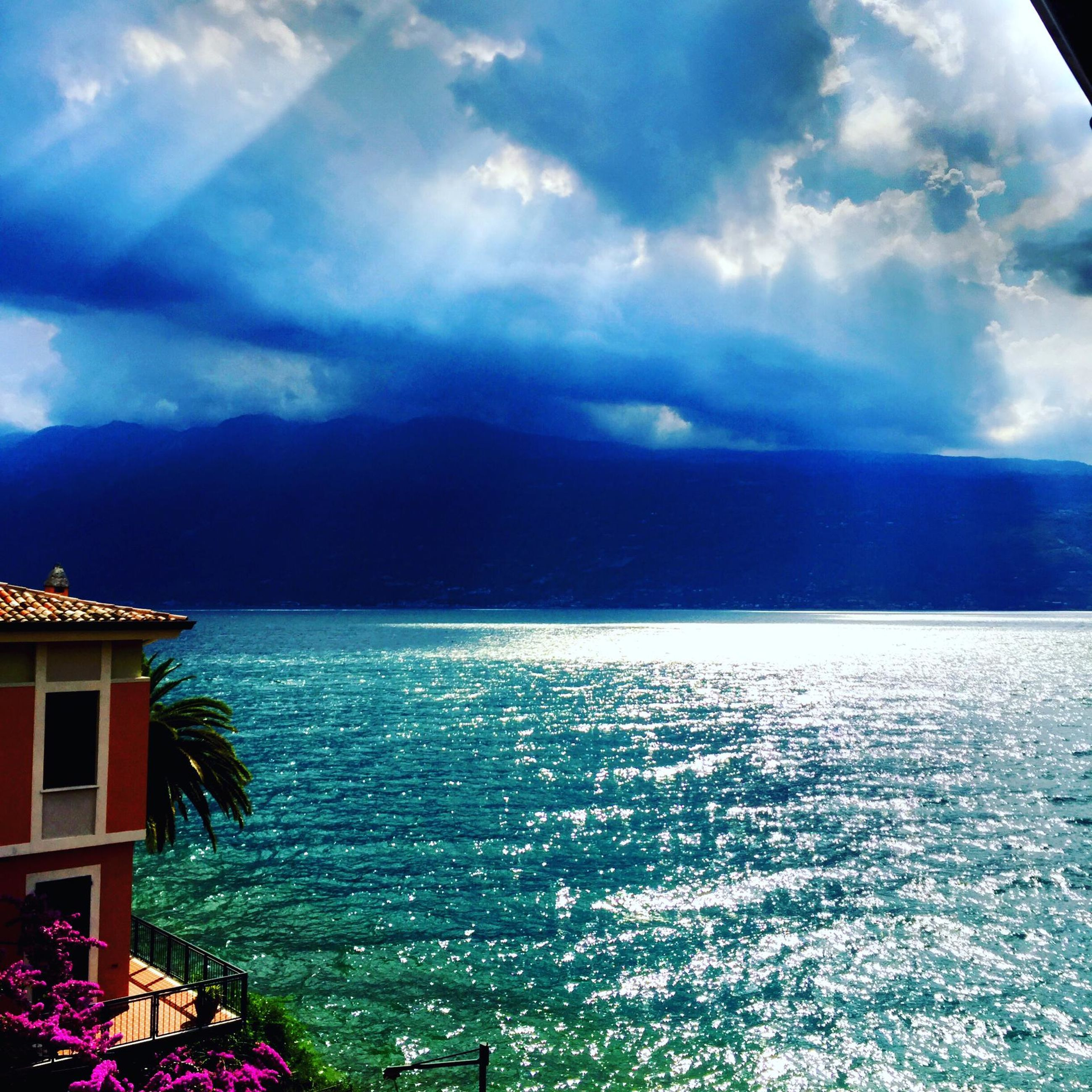 cloud - sky, sky, water, sea, beauty in nature, scenics - nature, architecture, nature, horizon over water, built structure, horizon, building exterior, no people, day, blue, tranquil scene, tranquility, outdoors, land, turquoise colored