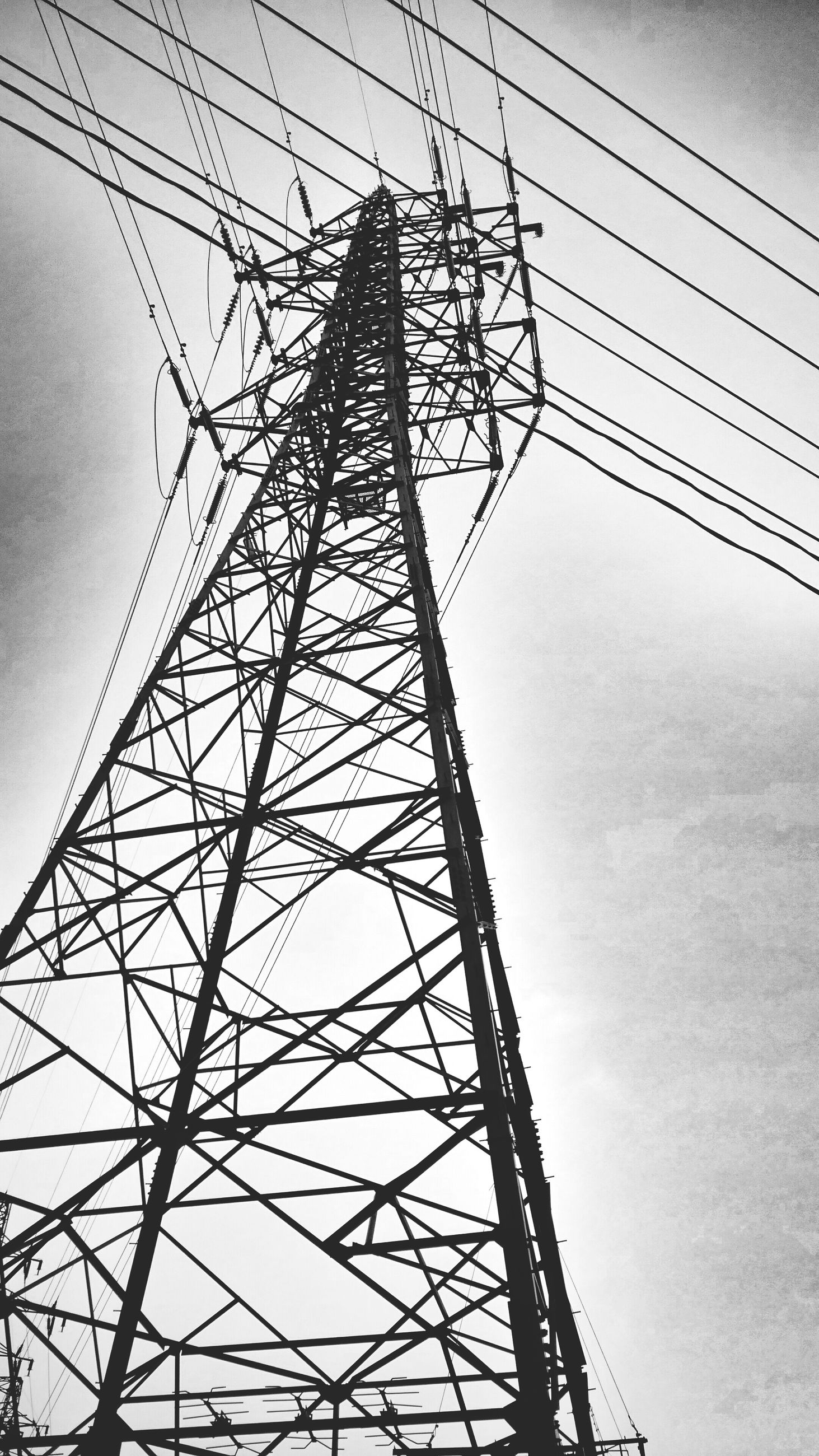 low angle view, electricity pylon, power line, connection, power supply, electricity, technology, fuel and power generation, sky, silhouette, cable, tall - high, clear sky, built structure, outdoors, day, metal, no people, dusk, complexity