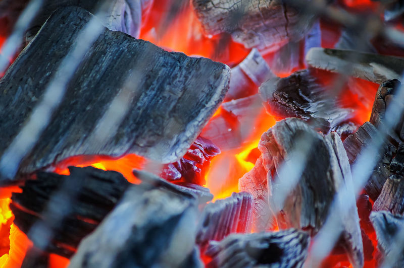 Firewood burning on barbecue grill