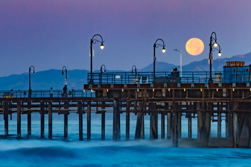 Santa Monica Pier Los Angeles, California Moon Water Pier Ocean Nature Outdoors Morning Night Street Light Architecture Built Structure Sea Dusk Waterfront Light Connection Blue