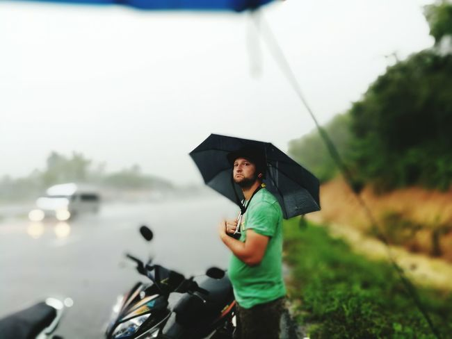 Rain One Person People Holding Leisure Activity Water Nature Adult Rain Motor Scooter Motorway Umbrella☂☂ Helmet Man Travel