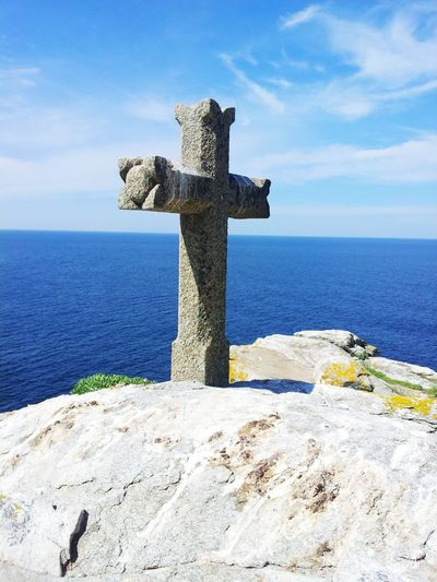 Cross over the ocean Sea Water Beach Cross Sculpture Statue Sky Horizon Over Water Crucifix Memorial Human Representation Gravestone Place Of Burial Idol Sculpted Tombstone Cemetery War Memorial Cross Shape