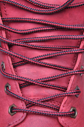 Binding laces in the shoe with a red leather close up Leather Training Footpath Red Shoe WeAreJux Close-up Footwear, Lace Macro Shoelace