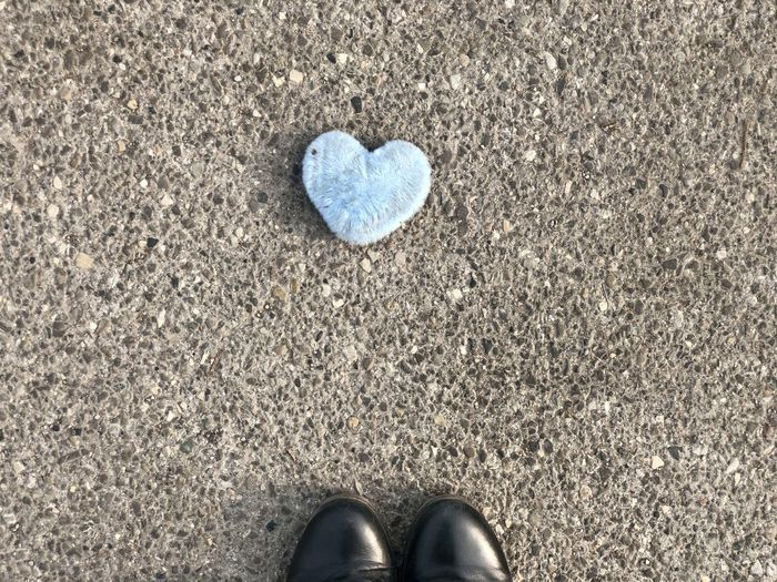 Low section of person standing on heart shape