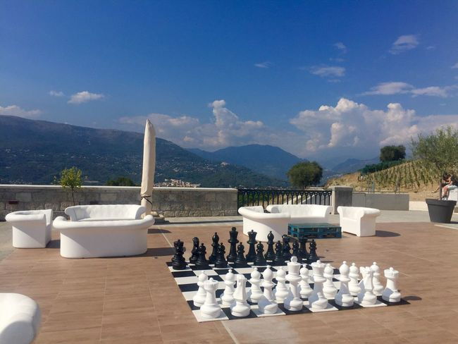 Relaxing Chess Chess Piece Chess Board Sky Mountain Leisure Games Cloud - Sky Table Day No People Strategy Large Group Of Objects Sunlight Tree Terrace Mountain Range Outdoors Nature Knight - Chess Piece Beauty In Nature Connected By Travel
