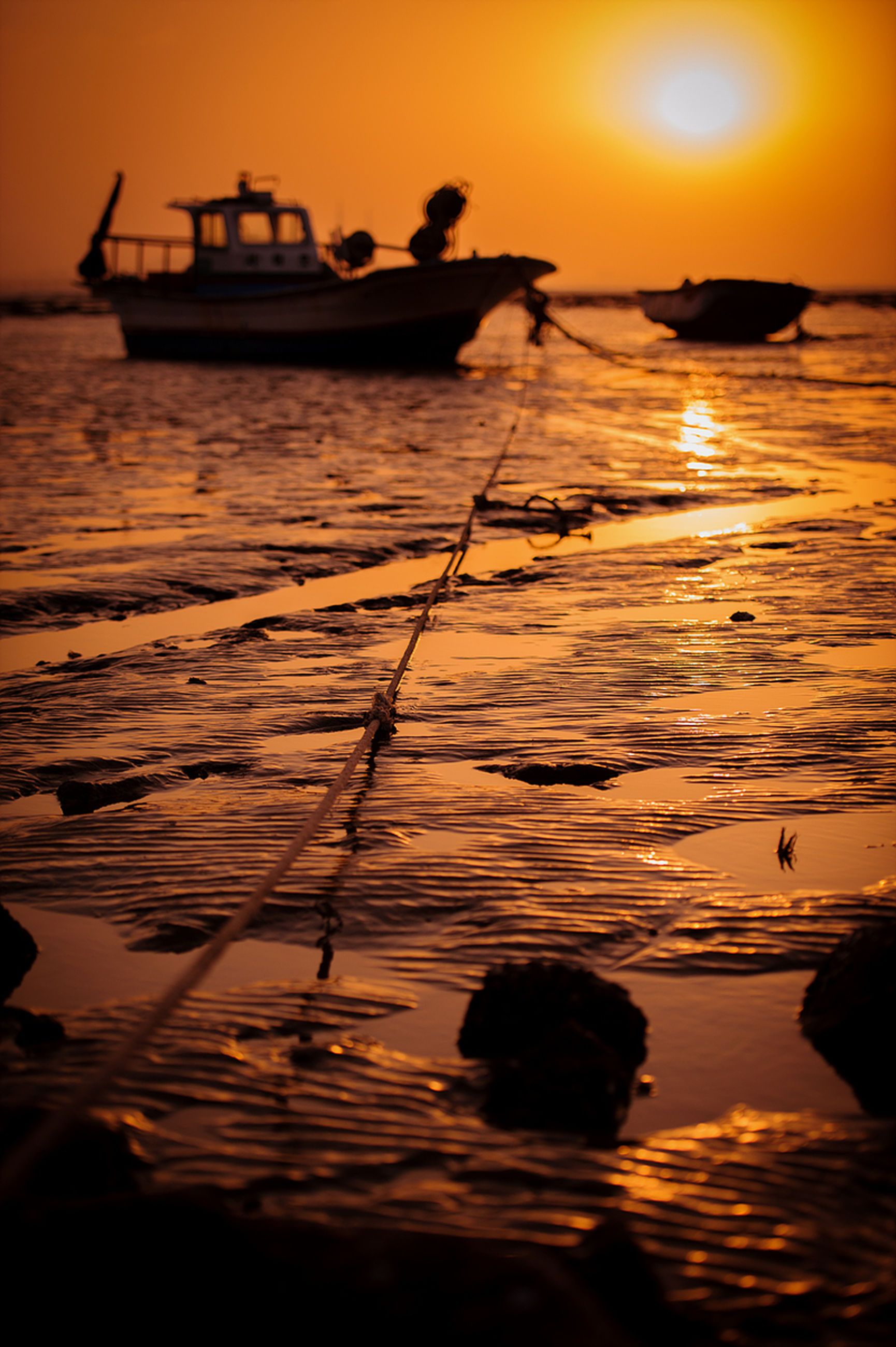 sunset, water, sea, silhouette, orange color, sun, reflection, scenics, horizon over water, nautical vessel, tranquil scene, beauty in nature, tranquility, boat, sky, idyllic, transportation, nature, beach, mode of transport