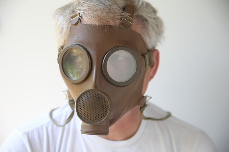 Old gas mask worn by senior man Army Surplus Creepy Disturbing Front View Gas Mask Headshot Indoors  Man Military Equipment Natural Light Old Army Gear Older Person One Person Scary Senior Straps Studio Shot Vintage