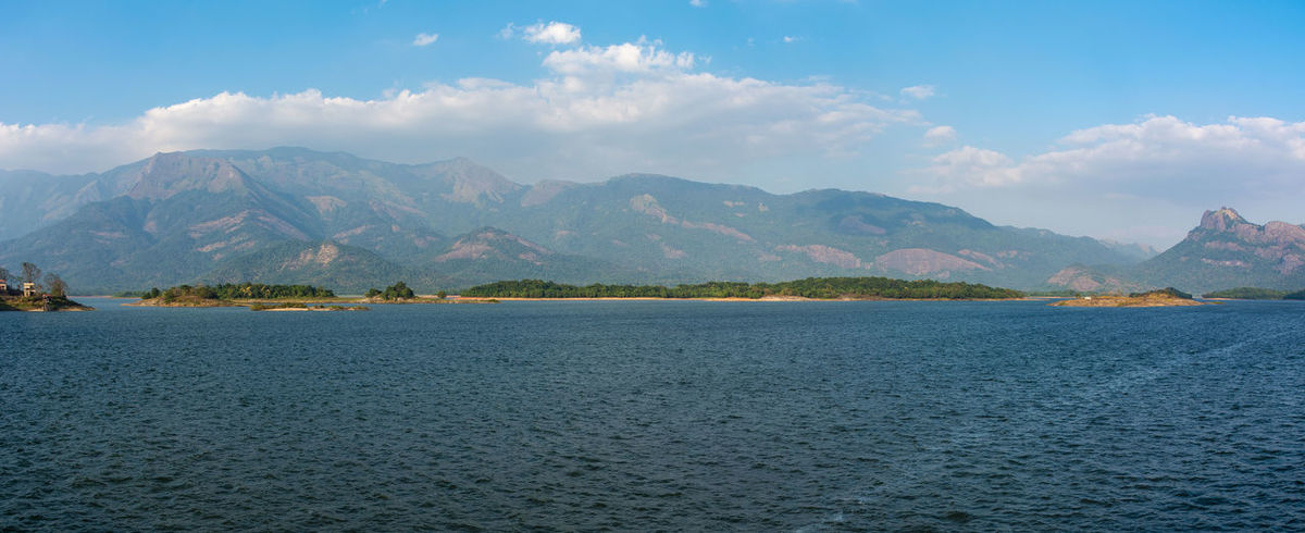 Scenery Water Surface Panorama Wide Angle Horizon Mountain Range Dam Clouds And Water Reflection Blue Blue Sky Green Peaceful Outdoors Sky Lake No People Beauty In Nature Mountain Range Day Water
