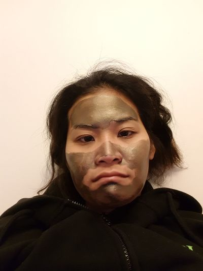 Clay Mask Face Mask Skin Care Asian  Brown Skin Sad Black Hair Yellow Light Misery Miserable Mindfulness Chill Lifestyles Portrait Headshot Looking At Camera Studio Shot Human Face Front View Close-up Human Skin Spa Treatment Beauty Spa Attractive Cheek Beauty Treatment Anti Aging Moisturizer Eyebrow Thoughtful