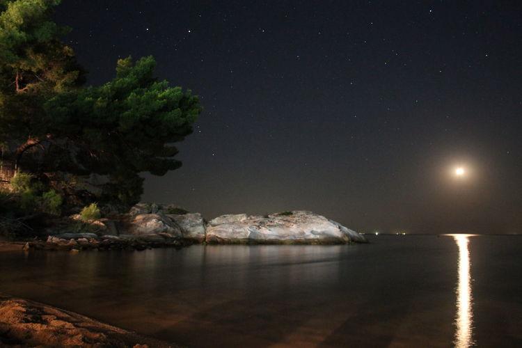 Water Sea Scenics - Nature Night Sky Beauty In Nature No People Nature Rock Idyllic Moonlight Star - Space Moon Illuminated