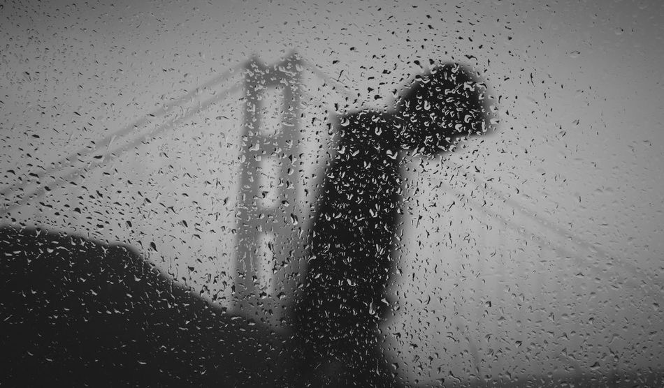 The Street Photographer - 2017 EyeEm Awards San Francisco San Francisco Bay California Blackandwhite Golden Gate Bridge Silhouette Shadow Streetphotography People Street Photography EyeEm Best Shots Rainy Days Golden Gate Bridge In Background Black & White Raindrops Window Trip Travel California Dreaming San Francisco, California EyeEm Ready   EyeEm Ready