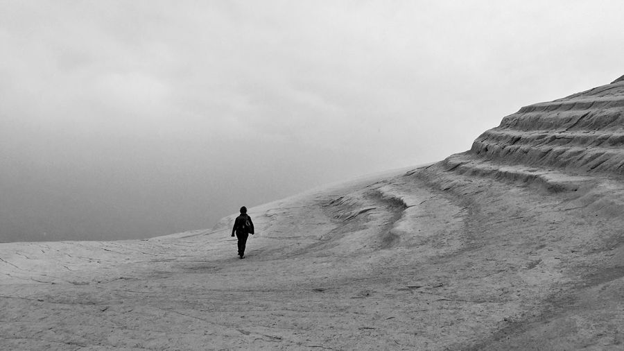 Girl Walking Through Clouds and Stones InTheMiddleOfNoWhere Blackandwhite