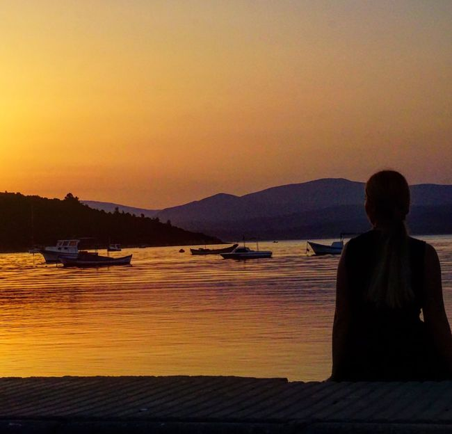 Sunset Scenics Sea Water Nature Beauty In Nature Sky Real People Sitting Tranquil Scene Leisure Activity One Person Outdoors Silhouette Mountain Lifestyles Clear Sky Nautical Vessel Vacations Day Done That. Second Acts
