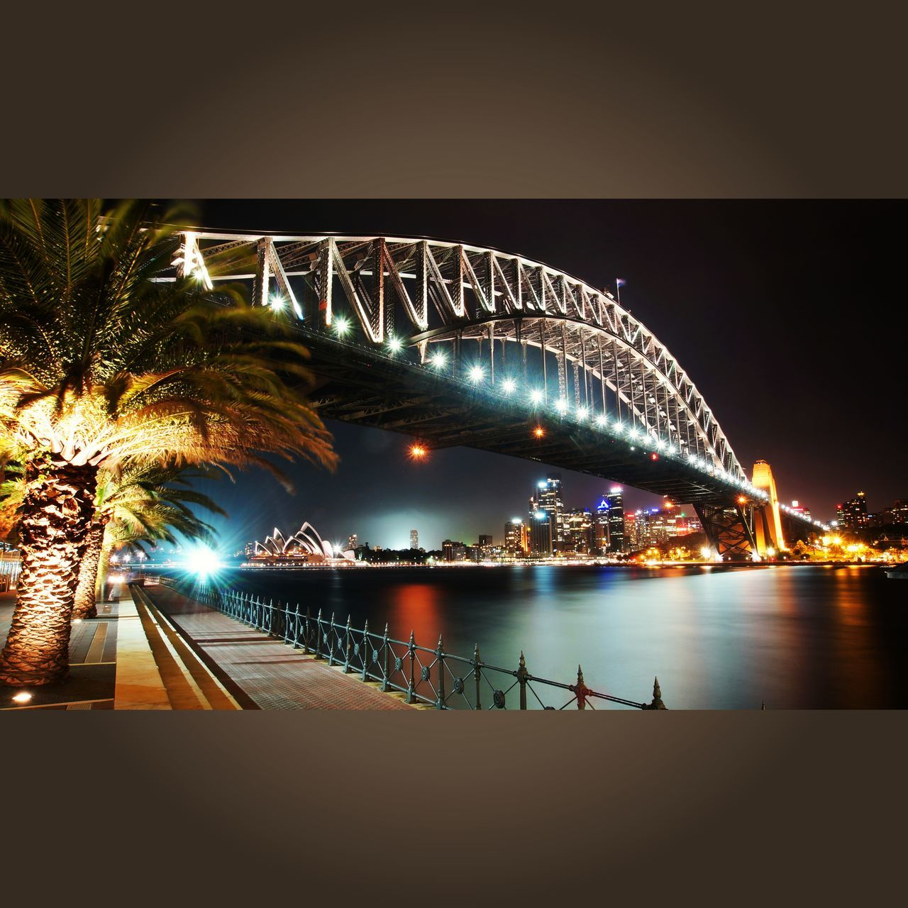 night, bridge - man made structure, illuminated, connection, architecture, transportation, outdoors, water, built structure, no people, clear sky, sea, travel destinations, sky, tree, nature