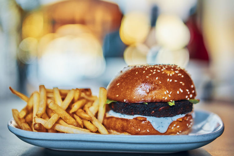 Close-up of burger and french fries in tray on table
