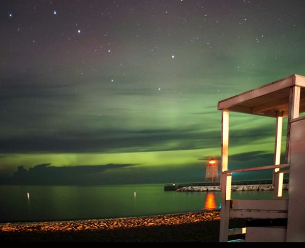 The Aurora Borealis performing once again at the beach . Summer Days Nature Lighthouse Light And Shadow Scenic, Charlevoix Lake Michigan On The Beach Beach Night PhotographyNorthern Lights Aurora Borealis Great Lakes Clouds And Sky Photography In Motion Fine Art Photography
