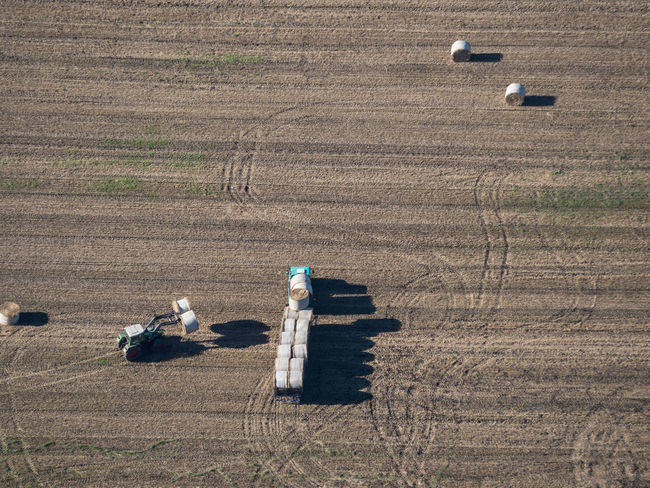 Hay Harvest III Aerial Aerial View Farmer Farming Farming Vehicles From Above  Harvest Hay Hay Crop High Angle View Men At Work  Outdoors Rolls Shadow Traces Tractor Flying High