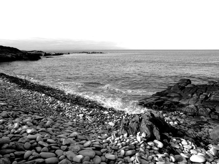 Looking out across the sea B/W edit B/w B/w Collection B/w Daily B/W Photography Beauty In Nature Calm Coastline Day Eye Em Scotland Horizon Over Water Idyllic Nature No People Outdoors Pebble Remote Rippled Rock Rock - Object Scotland Seascape Shore Sky Tranquil Scene Uk