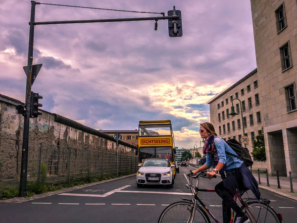Axel & Boris Berlin Berliner Ansichten Bike City City Life Cloud Cloud - Sky Cloudy Day Journey Land Vehicle Mode Of Transport Motorcycle On The Move Outdoors Parked Parking Road Road Sign Sky Sky_collection Stationary The Way Forward Transportation Woman On Bike