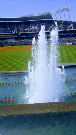 Kauffman StadiumStadium fountains. Sport Motion Grass Competitive Sport Outdoors No People Water baseball field Day Sky