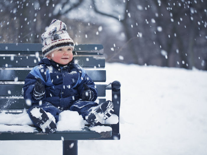Cute boy in snow during winter