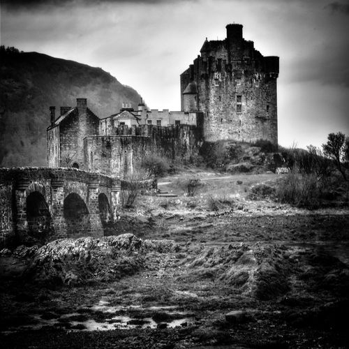 Eilean Donan Castle built in the mid 13th century and stood guard over the lands of Kintail also in the film Highlander and the James Bond film The World Is Not Enough Eilean Donan Castle Malephotographerofthemonth Blackandwhite Photography Bnw monochrome photography Landscape Bnw Castle Old Ruin Spooky Sky Architecture Building Exterior Built Structure Weathered The Past Archaeology Historic History Ancient