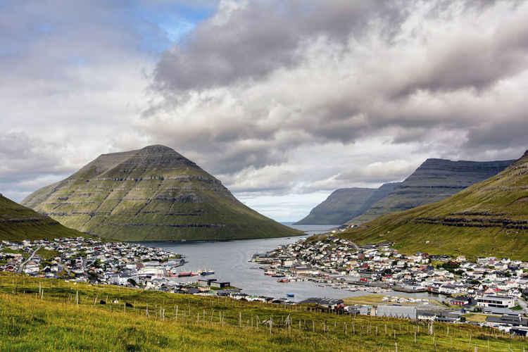 fishing port klaksvik, the Faroe Islands Klaksvik Beauty In Nature Cloud - Sky Day Faroe Islands Fisheries Grass Lake Landscape Mountain Nature No People Outdoors Scenics Sky Tranquility Water
