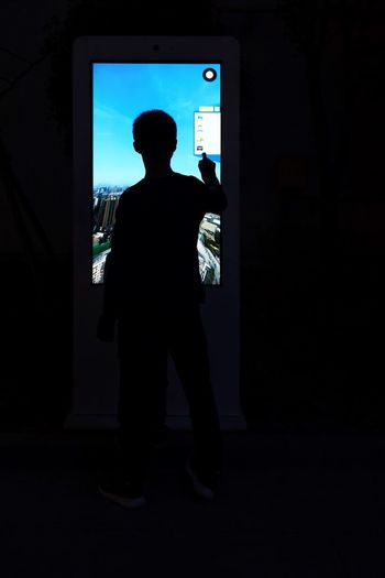 Panel Hightech Innovation Multimedia City Media Digital Standing Self Screen Information Interactivity Interacting Interaction Machine Kiosk Self Service Service Touch Touch Screen Terminal One Person Full Length Silhouette Standing Lifestyles Rear View Communication Night Technology